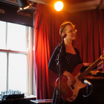Manon Trenza on bass guitar