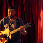 Paul Loughran on acoustic guitar and lead voice